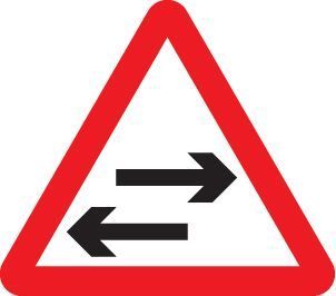 57759 Two way traffic crossing ahead class R2 Permanent 600mm tri (3mm aluminium composite)